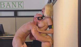 A hawt blonde is getting fucked in the bank by the bank robber