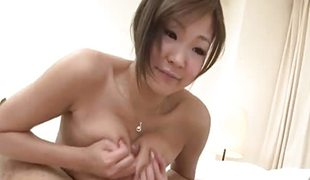 Nasty Hiyoko Morinaga uses her tits to jack off the c