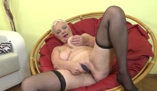 Huge pantoons granny fucking a sextoy passionately