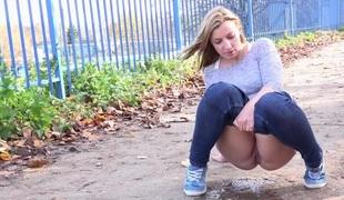 Peeing on a public sidewalk and soaking it