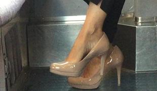 Beautiful feet in shoes high heels in train 2