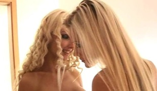Blond glamour women play together in an erotic tease