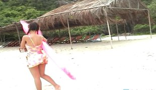 Sweet Asian with a shaggy pussy enjoys her body on a nice beach