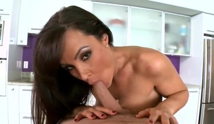 Brunette Lisa Ann eats fellows thick vertical fuck stick like crazy