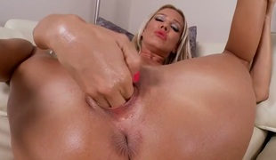 Golden-haired Sandy finds herself horny enough and takes sex toy in her fuck hole