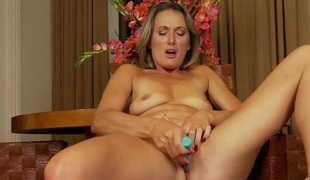 Mamma masturbating in her dining room chair