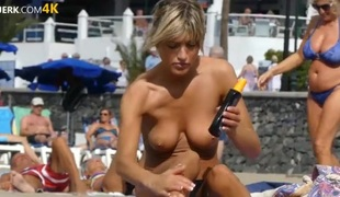 Beach playgirl sprays oil all over her titties