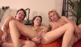 Lesbian milfs in bed having a crazy threesome