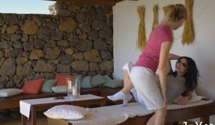 Two teenies fall into a frenzy during a hot massage