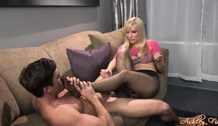 This babe sits on his face and grabs his woody to give it a good jerking