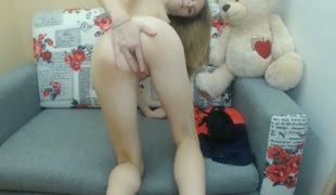 Skinny teen rubbing and fingering taut asshole from behind