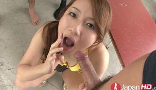 Oriental slut Kazumi Nanase is jerking and sucking two weenies
