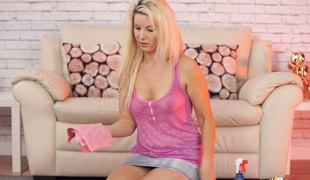 Charming blond sweetheart Sky cleans floor in the living room