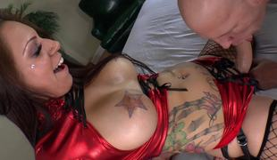 A big gazoo floozy with tattoos and a thong on is fucking her lover