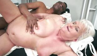 Old woman getting fucked by a black man and his massive meatpole