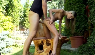It is a sunny day out, so the golden haired gal Doris Ivy is out with her lover in the garden. She is receiving an anal gangbang from the man and she sucks him off.