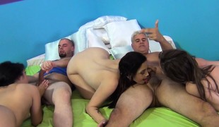 Four attractive hotties have fun with sex toys and enjoy two hard dongs