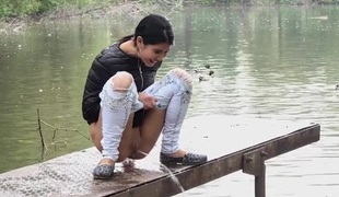 Public pissing girl in jeans goes in two places