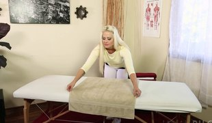 Blonde MILF masseuse acquires fucked by a handsome client