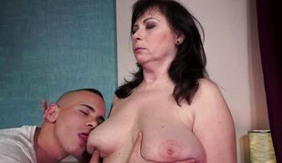 Voluptuous older woman fucked by a fresh cock