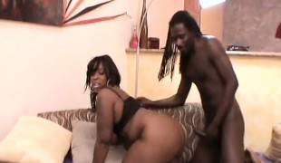 Chubby ebony woman enjoys the pleasure that a big dark penis provides