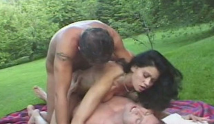 Two horny guys are ramming their cocks into one sexy wench