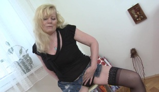 Big tits matured blonde in stockings moaning while masturbating